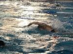 Победа в соревнованиях по плаванию.